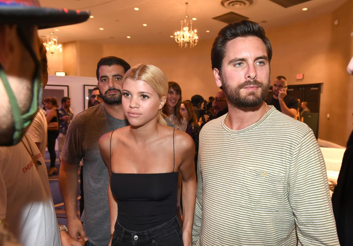 Sofia Richie (L) and Scott Disick attend Haute Living's VIP Pop-Up opening of Alec Monopoly from Art Life and David Yarrow from Maddox Gallery at Fleur De Lis Ballroom, Fontainebleau Miami Beach on December 7, 2017 in Miami Beach, Florida