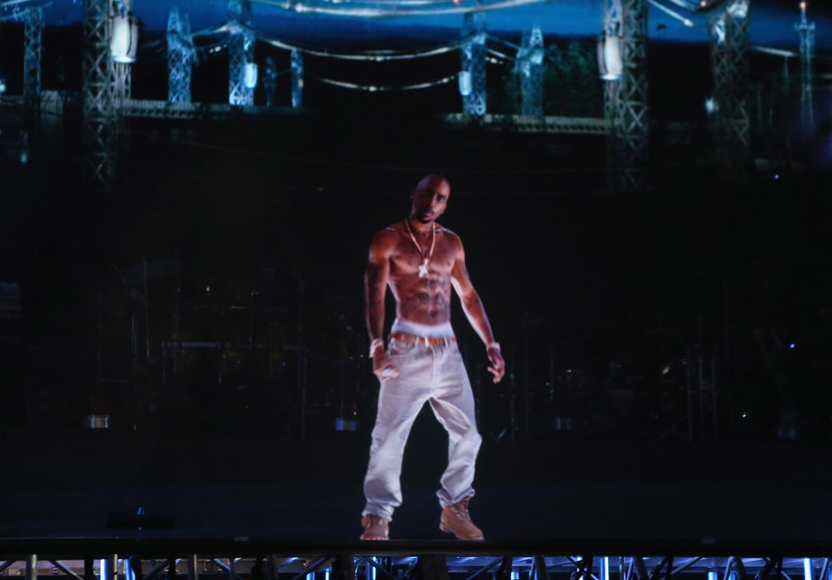 A hologram of deceased rapper Tupac Shakur performs onstage during day 3 of the 2012 Coachella Valley Music & Arts Festival at the Empire Polo Field on April 15, 2012 in Indio, California