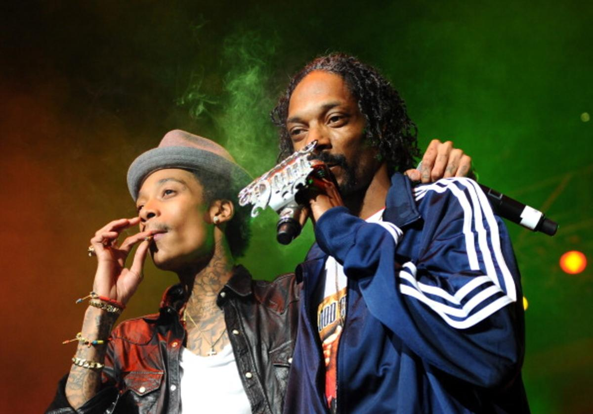 Rappers Wiz Khalifa (L) and Snoop Dogg perform on stage at Bankers Life Fieldhouse on February 2, 2012 in Indianapolis, Indiana.