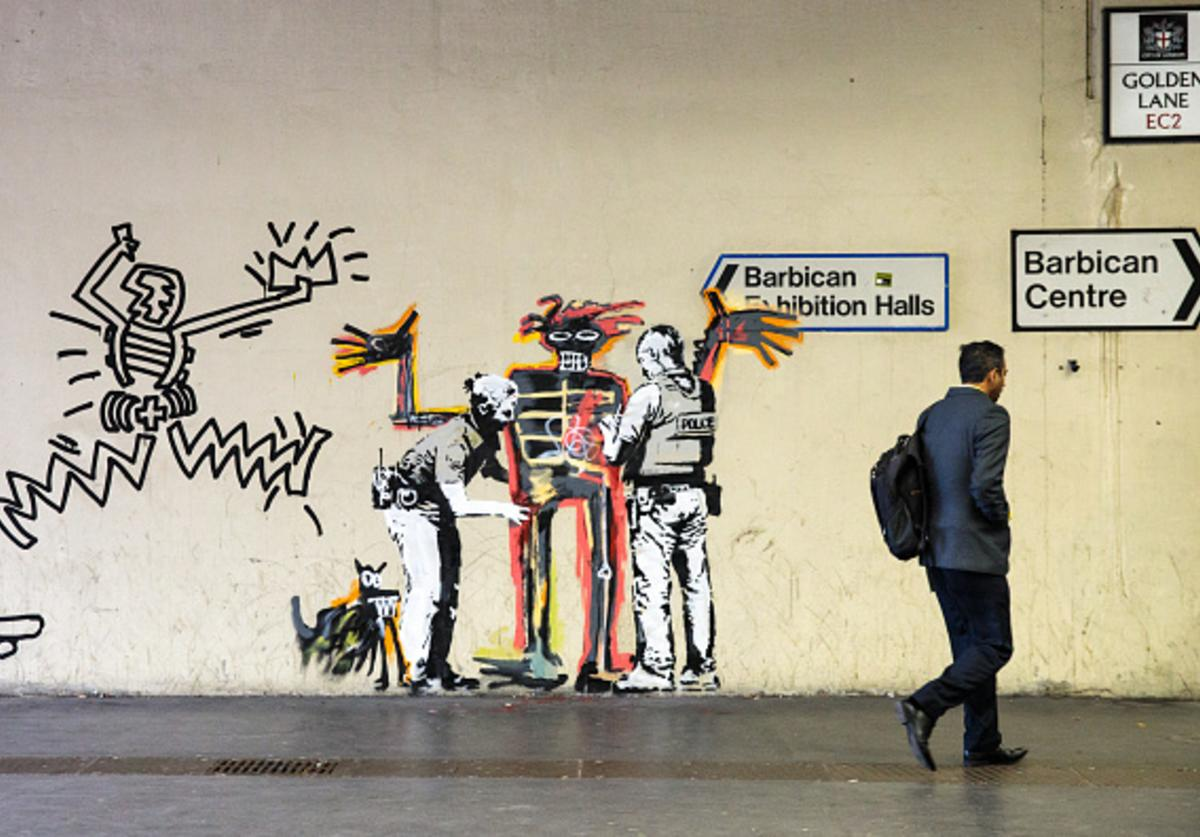 A man walks past a new work by street artist Banksy on a wall by the Barbican Centre on September 18, 2017 in London, England.