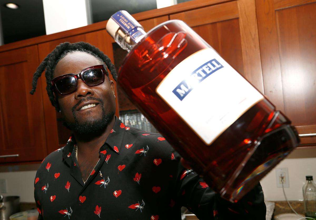 Wale holds a bottle of Martell Blue Swift at the H.O.M.E by Martell event on October 19, 2017 in Washington, DC