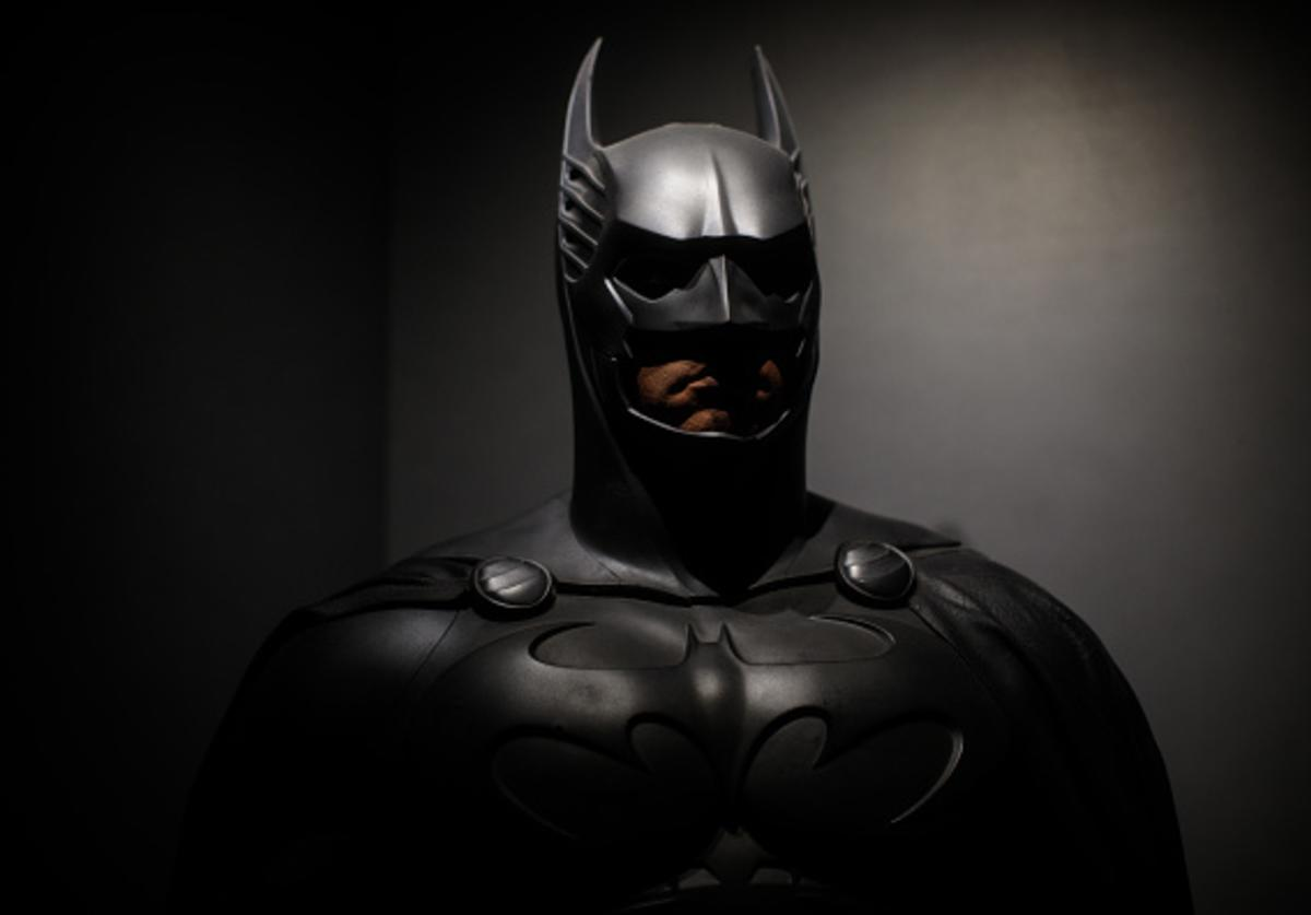 A Batman costume from the 1995 Batman Forever film worn by Val Kilmer and designed by Rob Ringwood and Ingrid Ferrin is on display at the DC Comics Exhibition: Dawn Of Super Heroes at the O2 Arena on February 22, 2018 in London, England. The exhibition, which opens on February 23rd, features 45 original costumes, models and props used in DC Comics productions including the Batman, Wonder Woman and Superman films.