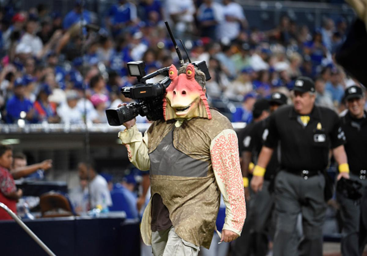 Television cameraman Ron Sharek, dressed as Star Wars's Jar Jar Binks, walks on the field before a baseball game between the San Diego Padres and the Los Angeles Dodgers at PETCO Park on September 1, 2017 in San Diego, California.