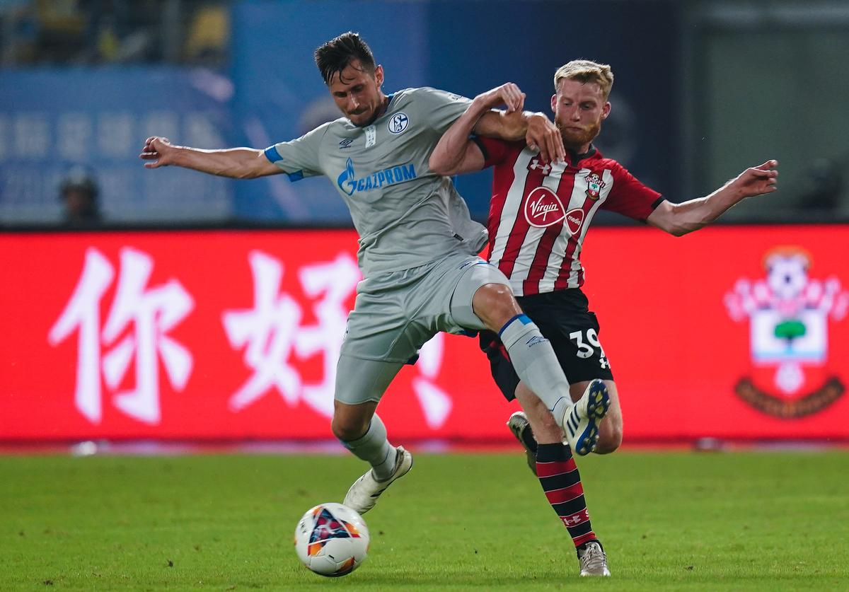 Steven Skrzybski of Schalke FC competes the ball with Josh Sims of Southampton FC during the 2018 Clubs Super Cup match between Schalke and Southampton at Kunshan Sports Center Stadium on July 5, 2018 in Kunshan, Jiangsu Provinceon, China