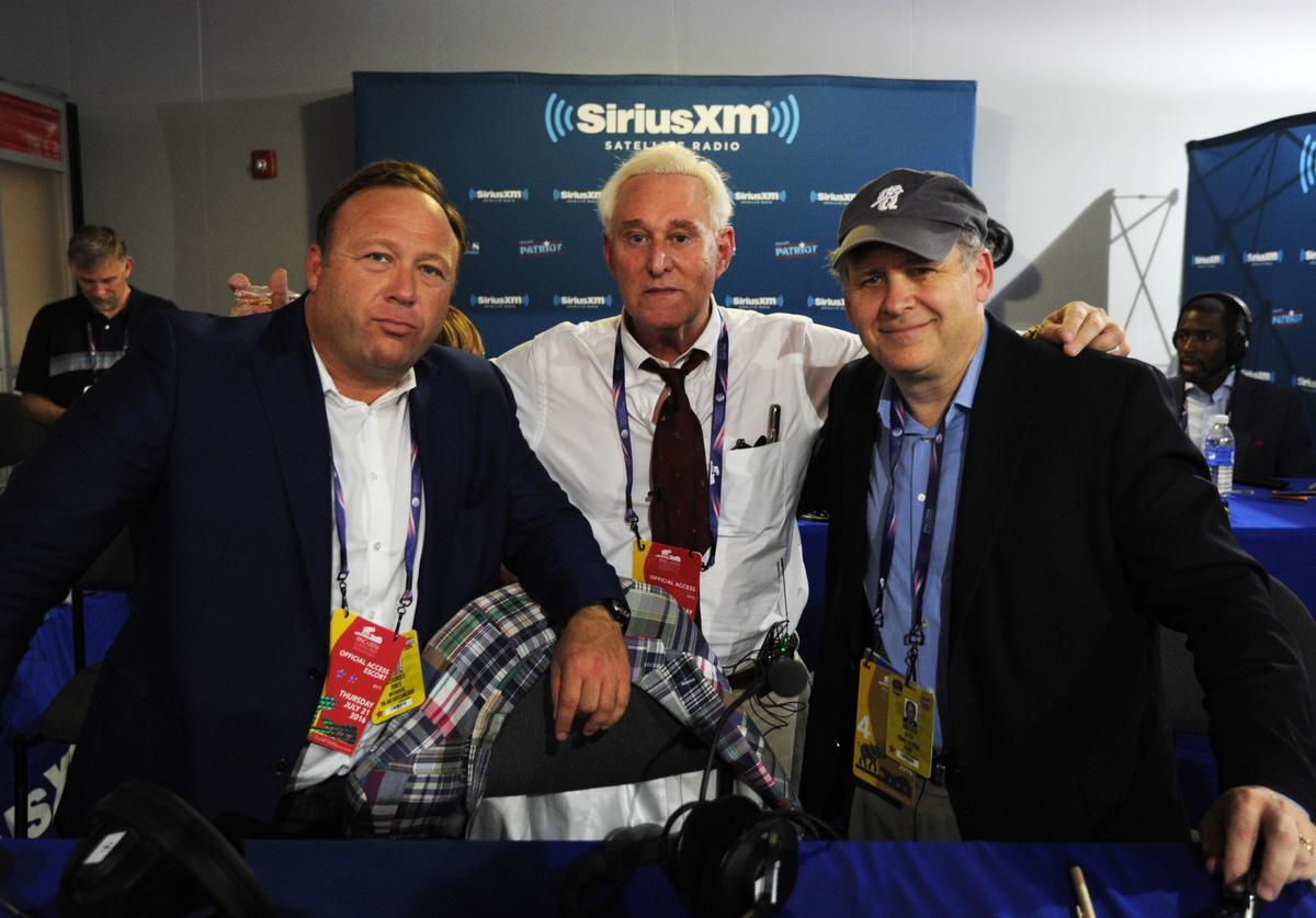 Alex Stone, of Infowars, Roger Stone, former Donald Trump advisor, and Jonathan Alter pose for a photo following an episode of Alter Family Politics on SiriusXM at Quicken Loans Arena on July 20, 2016 in Cleveland, Ohio.