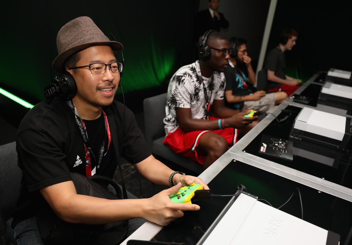 Game enthusiasts and industry personnel play 'Forza Horizon 4' during the Electronic Entertainment Expo E3 at the Microsoft Theater on June 12, 2018 in Los Angeles, California.