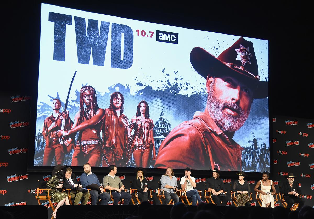 Angela Kang, Scott M. Gimple, Robert Kirkman, David Alpert, Gale Anne Hurd, Greg Nicotero, Andrew Lincoln, Norman Reedus, Melissa McBride, Danai Gurira, and Jeffrey Dean Morgan speak onstage during the NYCC panel and fan screening of 'The Walking Dead' episode 901 at The Theater at Madison Square Garden on October 6, 2018 in New York City