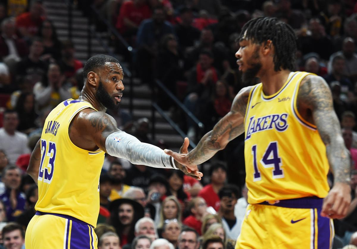 LeBron James #23 and Brandon Ingram #14 of the Los Angeles Lakers celebrate in the first quarter against the Portland Trail Blazers during their game at Moda Center on October 18, 2018 in Portland, Oregon.