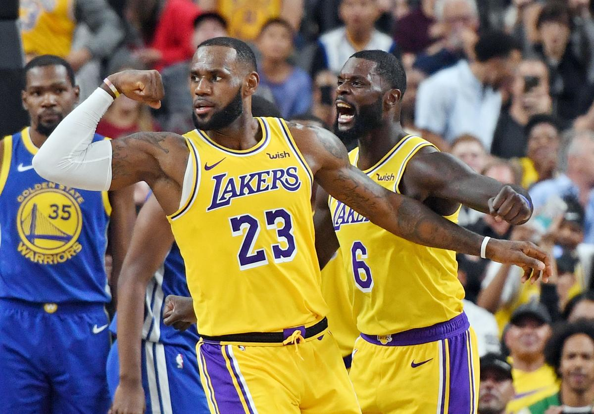 LeBron James #23 and Lance Stephenson #6 of the Los Angeles Lakers celebrate after James made a shot against the Golden State Warriors and was fouled during their preseason game at T-Mobile Arena on October 10, 2018 in Las Vegas, Nevada.