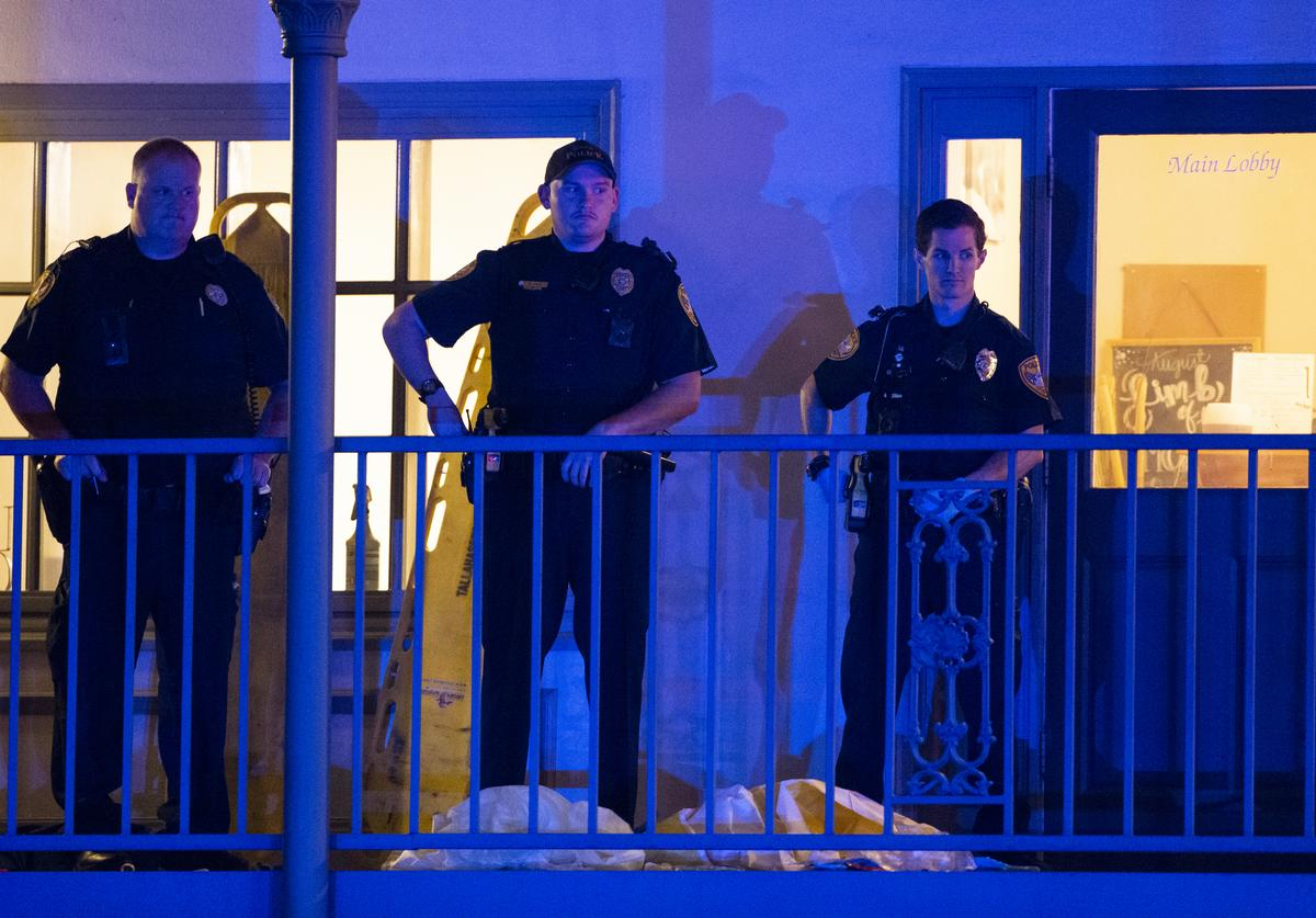 Tallahassee Police officers are stationed outside the HotYoga Studio after a gunman killed one person and injured several others inside on November 2, 2018 in Tallahassee, Florida. The gunman also died from what appears a self inflicted gunshot wound according to police.