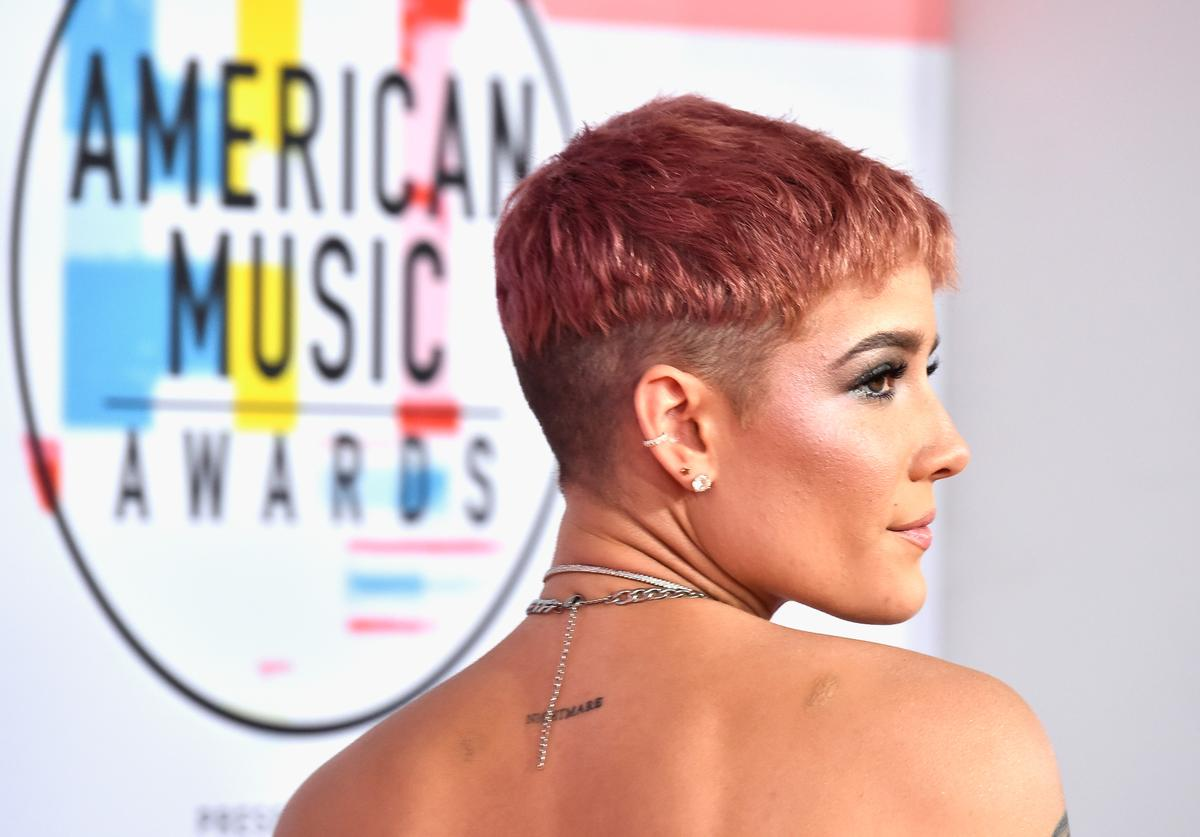 Halsey, hair, necklace, and tattoo details, attends the 2018 American Music Awards at Microsoft Theater on October 9, 2018 in Los Angeles, California
