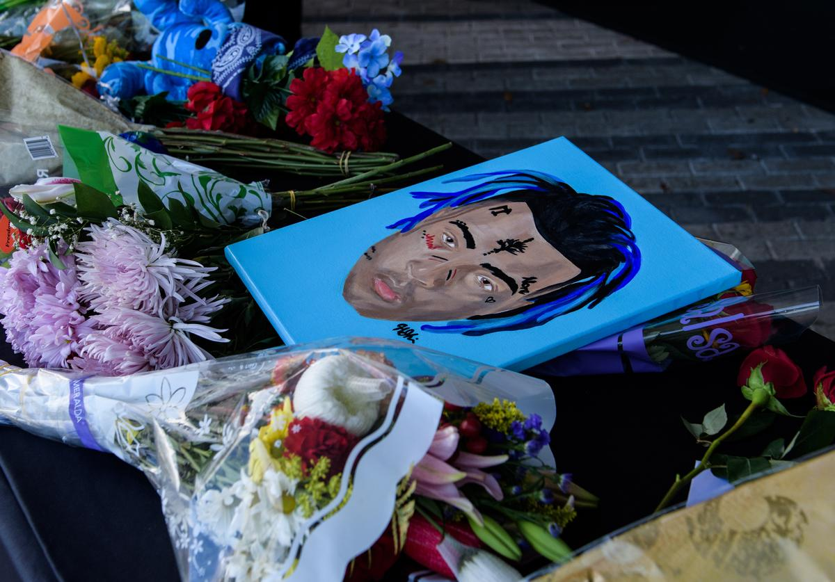 Fans leave items at a makeshift memorial outside the XXXTentacion Funeral & Fan Memorial at BB&T Center on June 27, 2018 in Sunrise, Florida