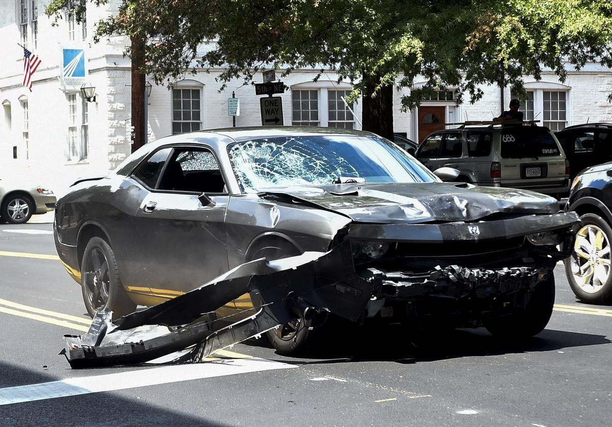 The silver Dodge Charger alledgedly driven by James Alex Fields Jr. passes near the Market Street Parking Garage moments after driving into a crowd of counter-protesters on Water Street on August 12, 2017 in Charlottesville, Virginia.