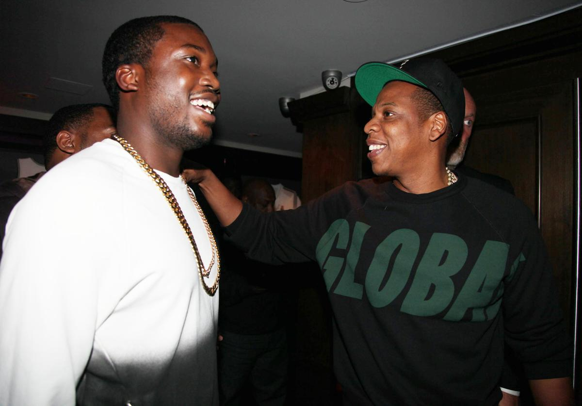 Meek Mill and Jay-Z attend the Premiere Of NBA 2K13 With Cover Athletes And NBA Superstars at 40 / 40 Club on September 26, 2012 in New York City