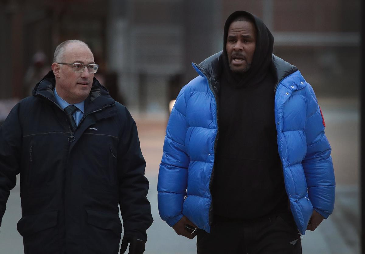 R&B singer R. Kelly (R) and his attorney Steve Greenberg leave Cook County jail after Kelly posted $100 thousand bond on February 25, 2019 in Chicago, Illinois. Kelly was being held after turning himself in to face ten counts of aggravated sexual abuse.