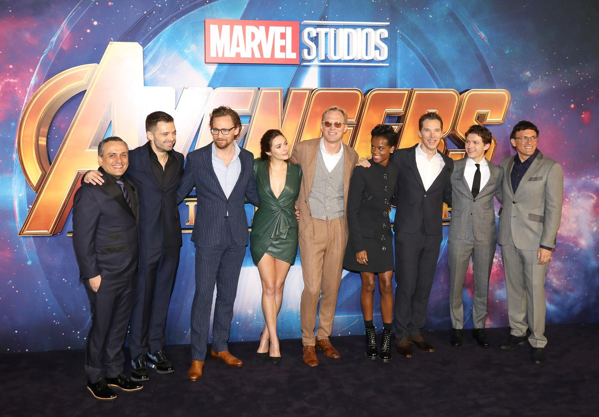 Director Joe Russo, actors Sebastian Stan, Tom Hiddleston, Elizabeth Olsen, Paul Bettany, Letitia Wright, Benedict Cumberbatch, Tom Holland and director Anthony Russo attend the UK Fan Event for 'Avengers Infinity War' at Television Studios White City on April 8, 2018 in London, England.
