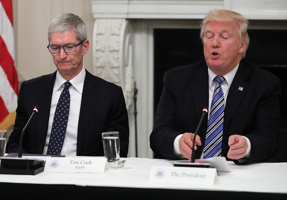 Apple CEO Tim Cook listens to U.S. President Donald Trump deliver opening remarks during a meeting of the American Technology Council in the State Dining Room of the White House June 19, 2017 in Washington, DC