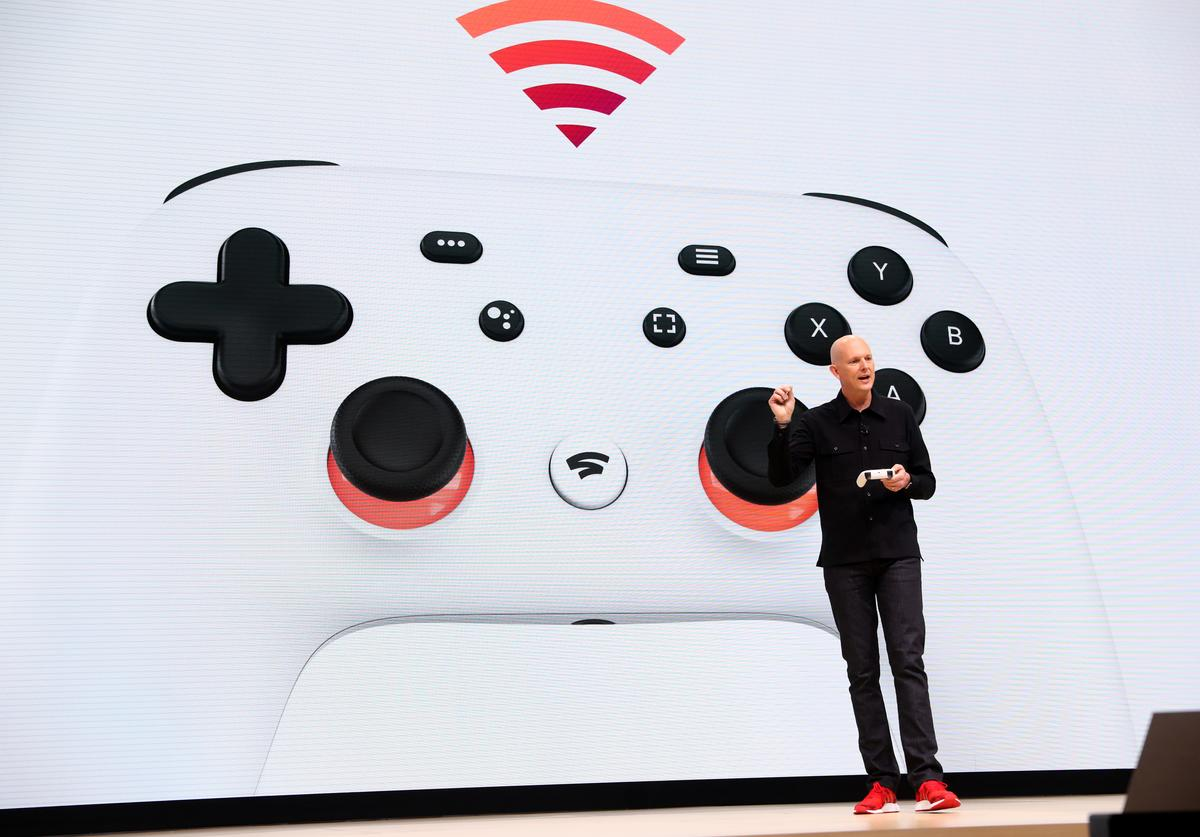 Google vice president and general manager Phil Harrison shows the new Stadia controller as he speaks during the GDC Game Developers Conference on March 19, 2019 in San Francisco, California. Google announced Stadia, a new streaming service that allows players to play games online without consoles or computers.