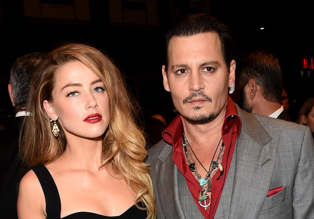 Actors Amber Heard (L) and Johnny Depp attend the 'Black Mass' premiere during the 2015 Toronto International Film Festival at The Elgin on September 14, 2015 in Toronto, Canada