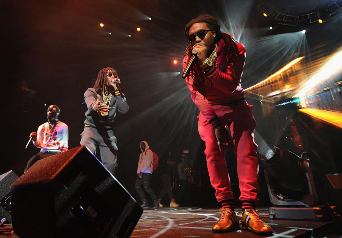 (L-R) Rappers Takeoff, Quavo, and Offset of Migos perform on stage at Power 105.1's Powerhouse 2014 at Barclays Center of Brooklyn on October 30, 2014 in New York City.