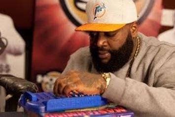 "Rick Ross Plays A Game Of ""Mastermind"" With Angie Martinez"