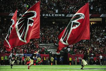 Watch This Falcons Fan Pass Out And Crash Into A Row Of Fans