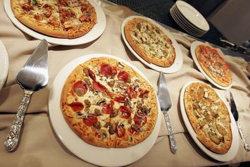National Pizza Day: Where To Cop The Best Deals On Some Cheesy Goodness