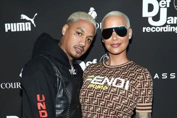 Amber Rose Shows Off Growing Baby Bump In Leopard Print Catsuit