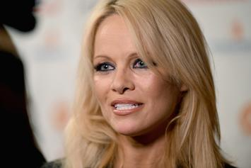 "Pamela Anderson Says She Feels ""Sick"" After Visiting Julian Assange In Prison"