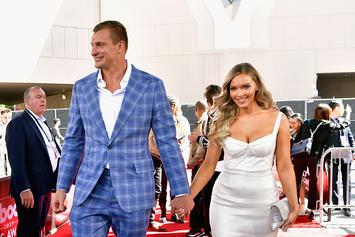 Rob Gronkowski Squats Camille Kostek At SI Swimsuit Party: Video
