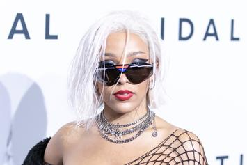Doja Cat Flaunts Her Bodacious Curves In All-White Outfit