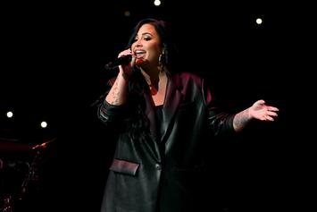 Demi Lovato Leaves Nightclub With Mystery Man Ahead Of Super Bowl Performance