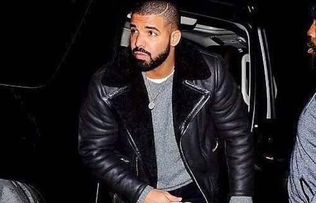 Drake getting out of a car