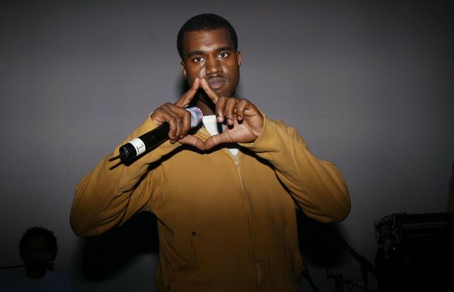 Kanye West throwing up the ROC
