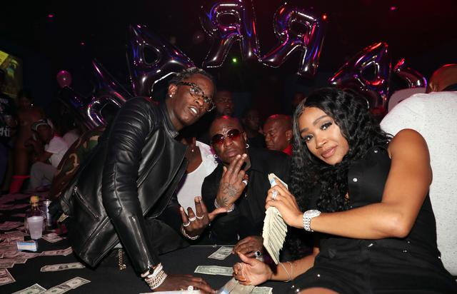 Young Thug, Birdman and his girl with a pile of cash