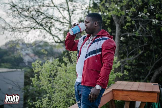 Blac Youngsta sips from a lean cup