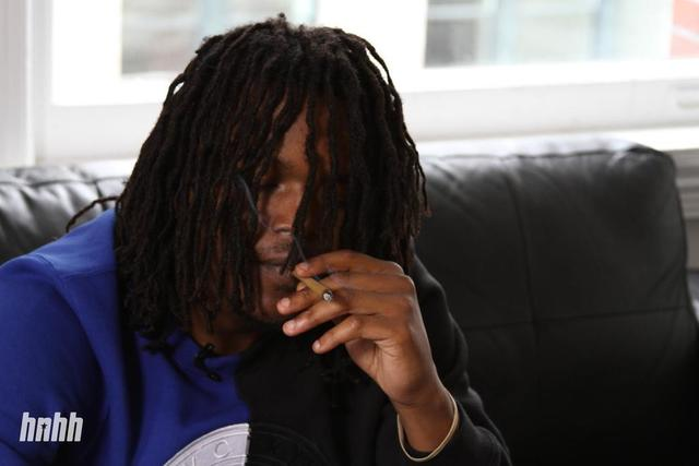 Young Nudy smoking a blunt at the HNHH office in NYC