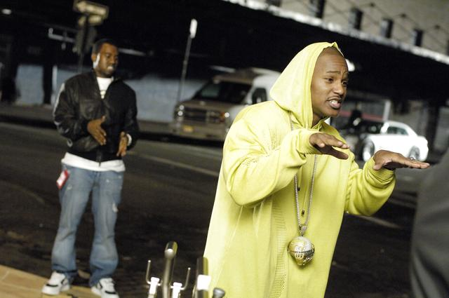 Cam'ron wearing his moving globe chain, on set with Kanye West
