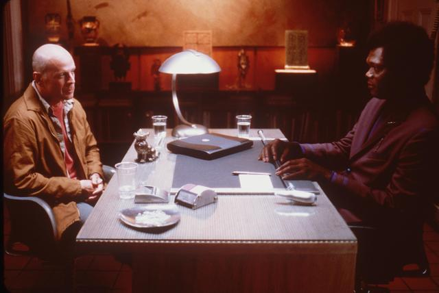 "Bruce Willis and Samuel Jackson in the movie ""Unbreakable"""