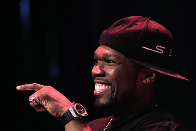 50 Cent pointing his finger and laughing