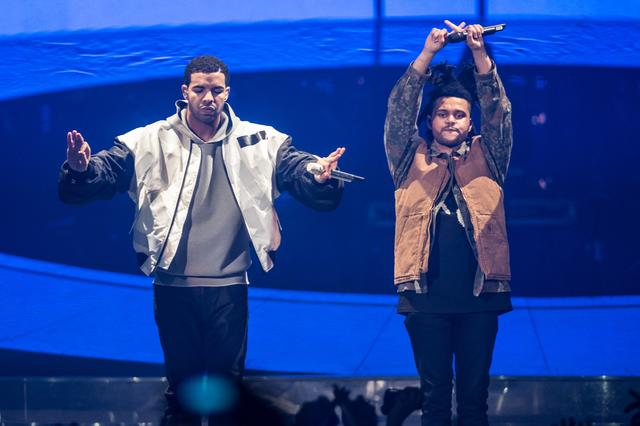 Drake and The Weeknd performs on stage during a date of his 'Nothing Was the Same' 2014 World Tour at Nottingham Capital FM Arena on March 16, 2014 in Nottingham, England.