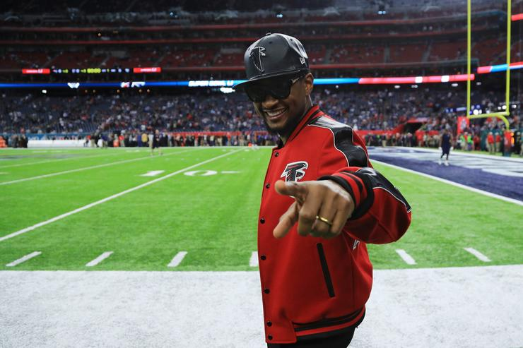 Recording artist Usher gestures prior to Super Bowl 51 between the New England Patriots and the Atlanta Falcons at NRG Stadium on February 5, 2017 in Houston, Texas.
