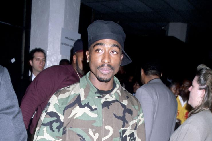 Tupac wearing army attire in 1996