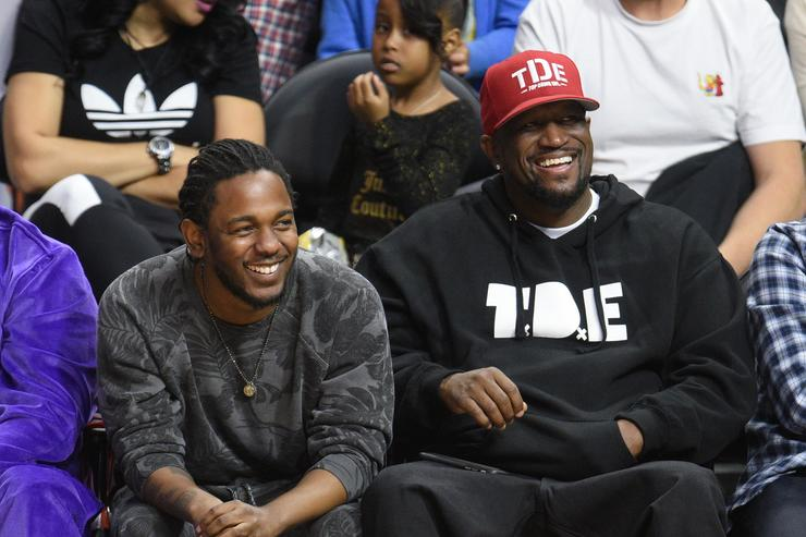 Kendrick Lamar (L) and Anthony Tiffith attend a basketball game between the Cleveland Cavaliers and the Los Angeles Clippers at Staples Center on March 13, 2016 in Los Angeles, California.