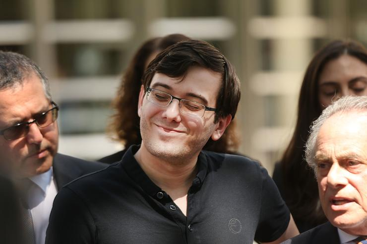 Martin Shkreli smiles while speaking to the media