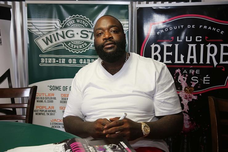 Rick Ross meets and greets fans at Wing Stop on May 26, 2014 in Deerfield Beach, Florida.