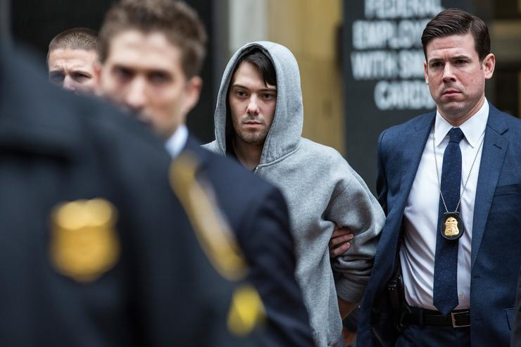Martin Shkreli (C), CEO of Turing Pharmaceutical, is brought out of 26 Federal Plaza by law enforcement officials after being arrested for securities fraud on December 17, 2015 in New York City. Shkreli gained notoriety earlier this year for raising the price of Daraprim, a medicine used to treat the parasitic condition of toxoplasmosis, from $13.50 to $750 though the arrest that happened early this morning does not involve that price hike.