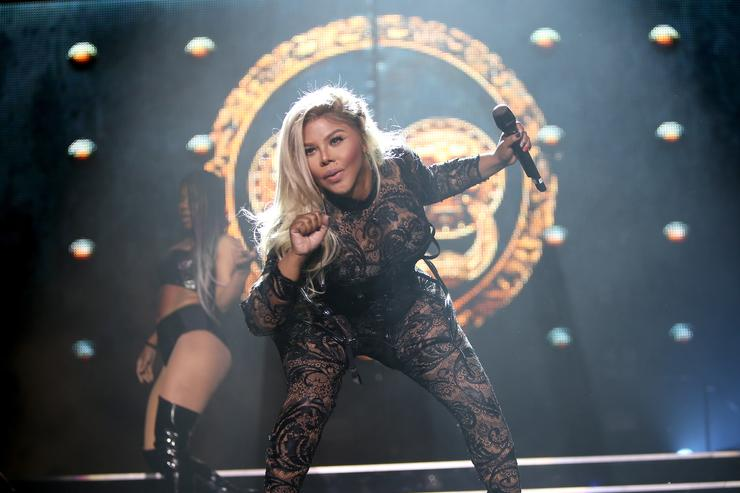 Recording artist Lil' Kim performs on stage during the Live Nation presents Bad Boy Family Reunion Tour sponsored by Ciroc Vodka, AQUAhydrate, DeLeon Tequila, Sean John and Macy's opening night at United Center on September 1, 2016 in Chicago, Illinois.