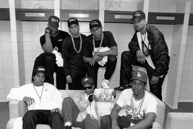 Rap group N.W.A. pose with rappers The D.O.C. and Laylaw from Above The Law (L-R standing: Laylaw, DJ Yella, Dr. Dre and The D.O.C. seated Ice Cube, Eazy-E and MC Ren)backstage at the Kemper Arena during their 'Straight Outta Compton' tour in June 1989 in Kansas City, Missouri.