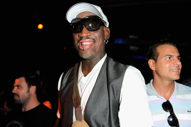 Dennis Rodman attends the Minimale Animale show during Mercedes-Benz Fashion Week Swim 2014 at Oasis at the Raleigh on July 22, 2013 in Miami, Florida.